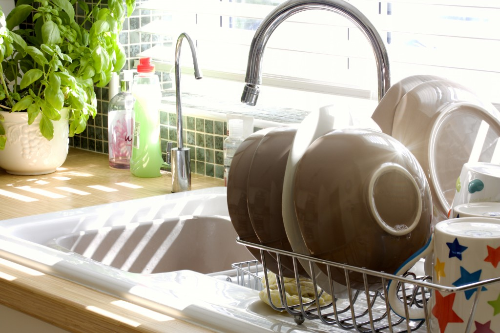 Kitchen sink and washing up in summer sunlight